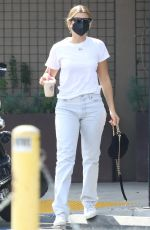 Sofia Richie Keeps it simple with a white tee and jeans as she meets a friend for coffee in West Hollywood