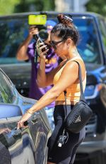 Vanessa Hudgens Gets comfy and rocks orange top and slippers after pilates workout in West Hollywood