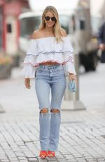 Vogue Williams Looks stunning wearing a ruffle off shoulder crop top and tight denim at Heart radio in London