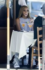 Winnie Harlow Has drinks with a friend at Il Pastaio in Beverly Hills