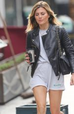 Zoe Hardman Looks chic in cotton shorts and matching sports top at Heart radio in London