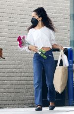 Zoe Kravitz Holds red roses as she leaves a supermarket in Upstate NY
