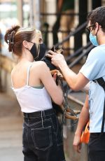 Zoey Deutch Goes crazy to say hi to her friend