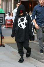 Addison Rae And her boyfriend Omer Fedi leave under cover from Bar Pitti in New York