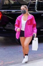 Addison Rae Leaves her hotel in a pink top and biker shorts in New York