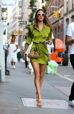 Alessandra Ambrosio Pictured in a stunning green dress walking in Soho