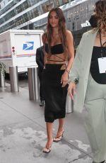 Amelia Hamlin Arrives in a black dress showing off her sculpted abs at the Revolve Gallery in New York