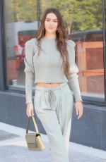 Amelia Hamlin Wows the crowds at NYFW with a sage green ensemble paired with nude heels, New York City