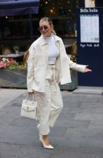 Ashley Roberts Flashes abs in white crop top and cream coords at Heart radio in London