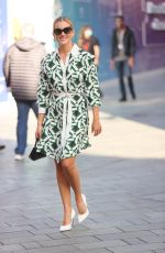 Ashley Roberts Looks chic in a bright flared floral dress at Heart radio in London