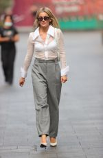 Ashley Roberts Wows in sheer shirt flashing bra and grey loose fit trousers at Heart radio in London