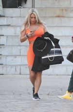 Bianca Gascoigne Showcases her ample assets in a busty orange bra and gym shorts spotted out in Rome
