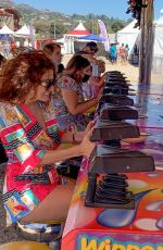 Blanca Blanco Rides the merry-go-round and plays games at the 39th Annual Malibu Chili Cook-Off fair in Malibu