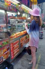 Blanca Blanco Visits Time Square and picks up some street food in New York