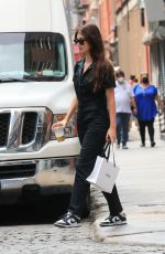Camila Morrone & Leonardo DiCaprio Seen arm in arm after stopping at a lingerie store in Manhattan's SoHo area