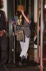 Cara Delevingne Carries a cane while trying to be low-key dressed in DIOR in New York