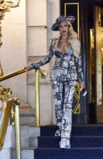 Christine Quinn Wears a dramatic newsprint outfit as she exits the Plaza Hotel in New York