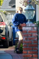 Elizabeth Olsen Rocks a Reebok sweatshirt with matching shorts and sandals to visit a friend in Los Angeles