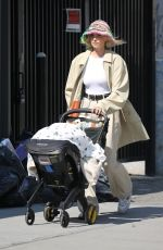 Elsa Hosk Looks stylish while strolling with her baby daughter Tuulikki in Manhattan