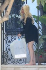 Erika Jayne Looks glamorous in a short nightshirt as she gets a pie delivered to her house in Los Angeles