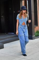 Hailey Baldwin Bieber Keeps it casual donning oversized jeans and a cropped crochet top stepping out for lunch in New York