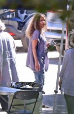 Halle Berry Is seen photo bombing a selfie while filming a commercial for Sweaty Betty workout clothes in Malibu