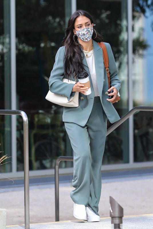 Jessica Alba Gets dressed in a sage green pantsuit for a day at the Honest Headquarters in Playa Vista