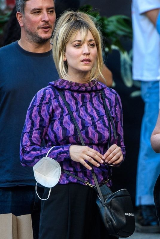 Kaley Cuoco Looks trendy in a purple patterned top as she is pictured shopping in Berlin