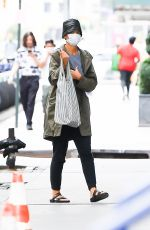 Katie Holmes Wearing a green jacket and leather bucket hat in New York City