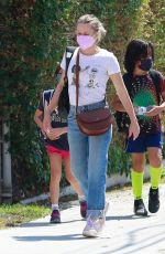 Kristen Bell Chatting with friends while out running errands in Los Angeles