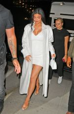 Kylie Jenner Debuts her baby bump as she steps out in a short plugging white dress and duster in New York City