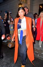 Kylie Jenner Rocks a statement orange coat and shows off her belly on the way to dinner in New York