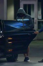 Lady Gaga Attempts to be incognito as she makes a swift exit from LAX