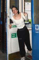 Lily Allen Looks rough as she is spotted in fluffy slippers calling out for a friend from the Back Door of the theatre in London