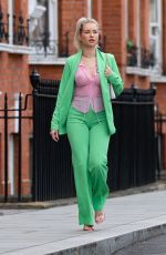 Lottie Moss Looks chic and stylish pictured out in Chelsea in a PrettyLittleThing Green suit and a sheer pink shirt from the brand
