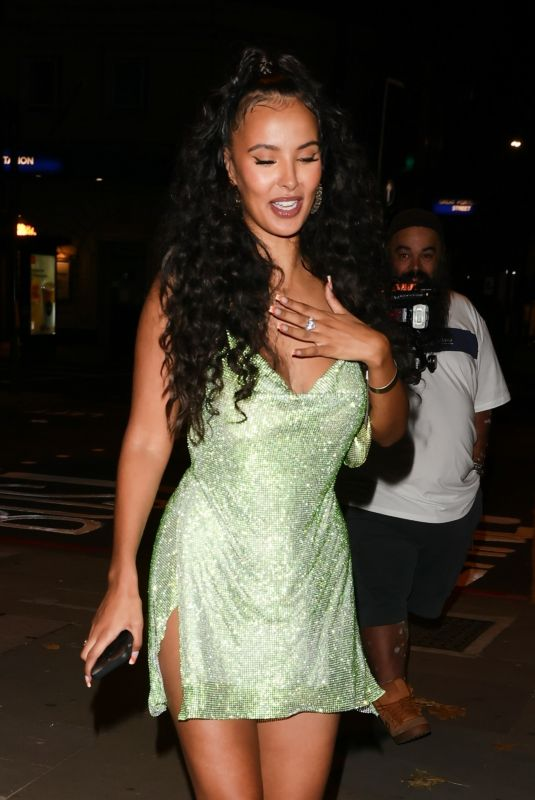 Maya Jama Flashes a huge diamond ring in a sparkling metallic gold dress at Tiffany Calvert's party in London