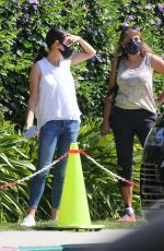 Mila Kunis Chats with other parents as she waits to pick up her kids after swim class in Los Angeles