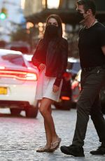 Mila Kunis Gets into a Porsche Cayenne while filming a night scene on the set of