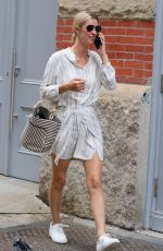 Nicky Hilton Is make-up free and looks stylish in all white while busy on the phone around Manhattan's Soho area