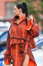 Nicole Williams Wears an orange outfit during a photoshoot in Soho