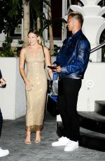 Olivia Holt Chats with a friend after attending a star-studded event at the Sunset Tower Hotel in Los Angeles