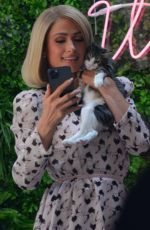 Paris Hilton Cuddles up to some kittens while doing a photo shoot at Crumbs and Whiskers along Melrose Avenue in West Hollywood