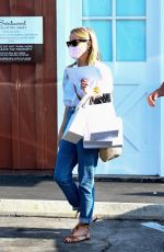 Reese Witherspoon and her older son Deacon go shopping together at the Brentwood Country Mart in Brentwood