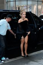 Rita Ora Is pictured in black mini dress and matching heels in New York