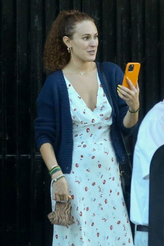 Rumer Willis Makes a FaceTime call after lunch with a friend at Bacari restaurant in Silver Lake