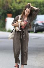 Scout Willis Carries her dog in one arm as she heads to her sister Rumer