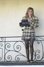 Suki Waterhouse Filming with vintage cars and video cameras for a photo shoot in a run down motel
