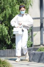 Zoey Deutch Steps out in an all white ensemble for coffee with a friend at Verve Coffee Roasters in West Hollywood