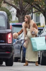 Millie Mackintosh Shows off her burgeoning baby bump in London
