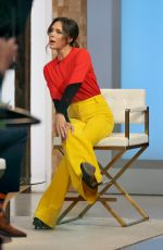 Victoria Beckham Pictured in a colorful stylish outfit during an interview at the